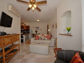 Playa del Carmen condo photo - Living area with flat screen TV.