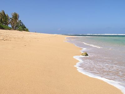 Oceanfront and beachfront living.  This is the beach at 'Kauai Beach Villa'.