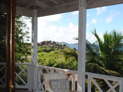 View from inside living room across the deck and out to the rocks at the Baths.