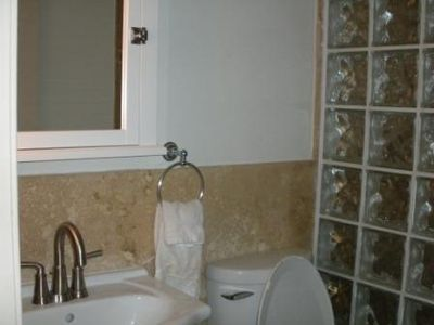 remodeled bathroom with glass block walkin shower