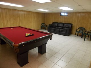 Old Saybrook house photo - furnished game room in basement