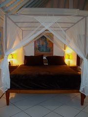 Bora Bora house photo - Beautiful four poster bed in opulent bedroom facing the lagoon!