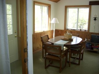 3 season porch dining area - Gilford cottage vacation rental photo