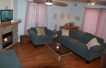 Lancaster townhome rental - Living Room with LED TV, Fireplace, and Ceiling Fan
