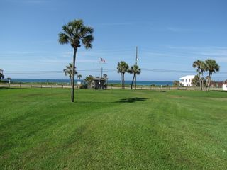 Sunnyside condo photo - Lots of green space! View from middle of courtyard facing beautiful Gulf.
