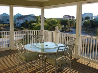 Harbor Island house photo - Spacious front porch is a great place for dining al fresco.
