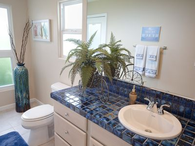 This bathroom off the great room also opens onto the lanai (porch).