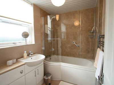 Modern bathroom with shower. Towels supplied free