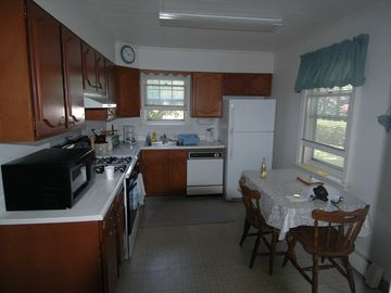 View of kitchen while standing in the dining room.