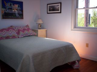 Provincetown condo photo - Bedroom with full size bed, cathedral ceilings and skylight