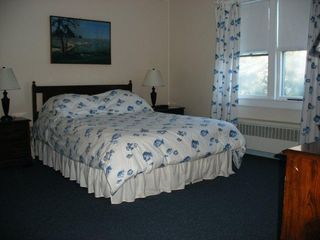 East Orleans house photo - Master bedroom offers a queen size bed with an adjoining half bath.