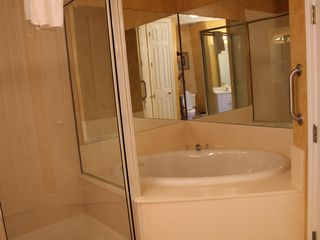 Orange Beach condo photo - Master bath jacuzzi tub and shower