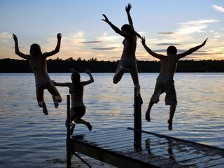 Windham cottage photo - Late night sunset jump off the dock!