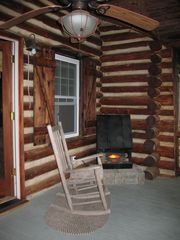 Farmville cabin photo - Cozy Front Porch Rocker with Fireplace & Lakeview