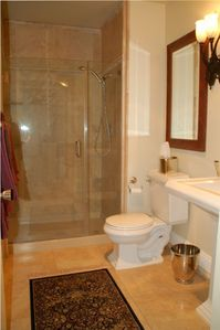 Marble Lined Main Bathroom