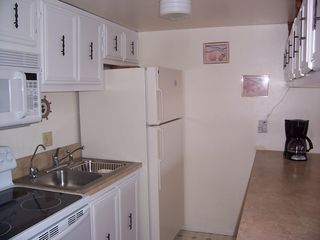 Treasure Island condo photo - Kitchen with ceramic cooktop stove, microwave and refrigerator.