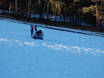 Sledding on golf course directly across the street from our cabin