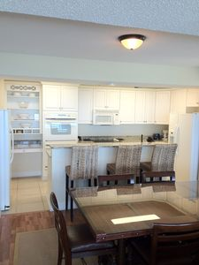 Fully equipped kitchen with two refrigerators, two ovens, and two dishwashers