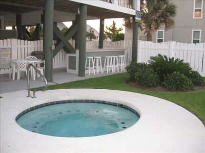 Unwind & chat with friends in oceanfront hot tub.  It's 5 o'clock somewhere!