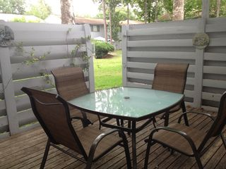 Gainesville condo photo - Private back porch with brand new patio furniture. Opens right out to the pool!