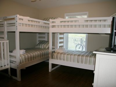Second bunkbed room showing full size portable crib on the left! Can be moved!