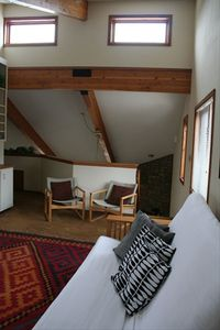 2nd living room in loft with view of clerestory windows above.
