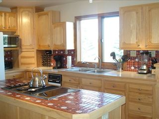 Bozeman house photo - Spacious kitchen with breakfast nook overlooking patio, pond and mountains.