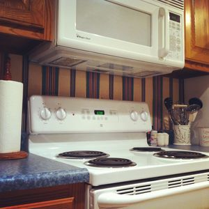 Pigeon Forge chalet rental - Our kitchen includes microwave, coffee machine, and blender.