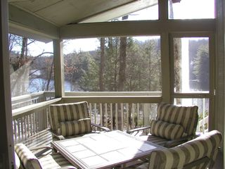 Brevard cottage photo - Screened-in patio over looking the lake