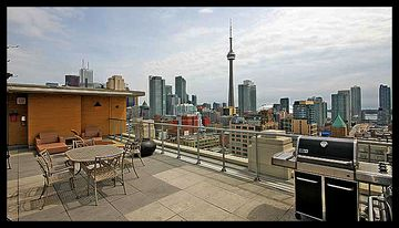 Rooftop patio with gardens, tanning chairs, BBQs, and 360 views of the city!