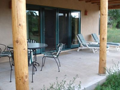 The back porch is a great spot to relax and enjoy meals under New Mexico skies.