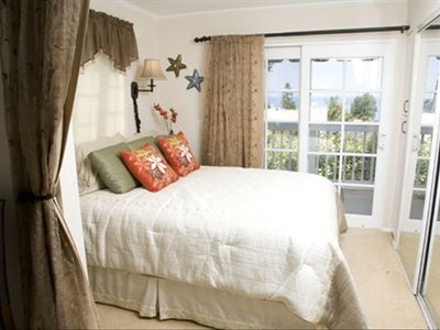 Bedroom Area with Queen Size Bed; French Doors and Ocean View