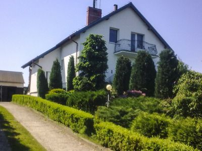 A stunning lakeside house - living room with the fireplace, terrace, 4 bedrooms, garden.