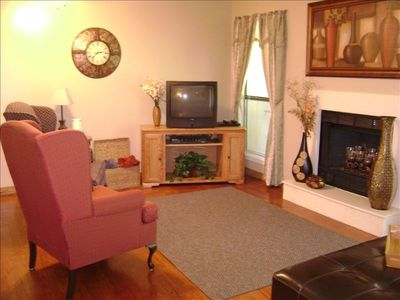 EXTRA SITTING AREA - Sit in front of fireplace & TV to enjoy your favorite show