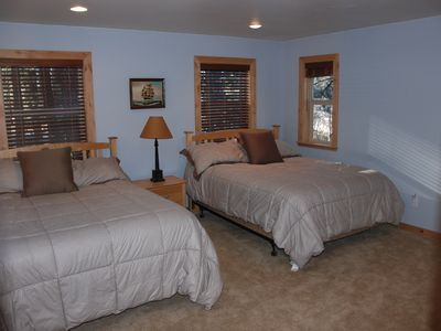 Downstairs bedroom with 2 queen sized beds