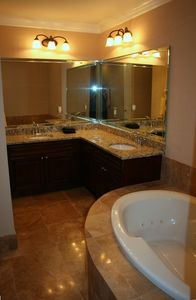 Master Bath Has Jacuzzi Tub, Granite Countertops, & Travertine Walk-In Shower