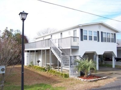 Oceanside Village, Surfside Beach, SC Raised 3BR/2BA beach house front, sleep 8