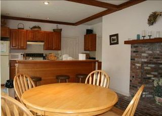 East Orleans house photo - Large table and breakfast bar off the Kitchen.