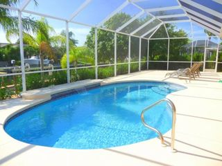 Cape Coral house photo - Electric heated pool has maximum depth of 5 feet and includes waterfall feature