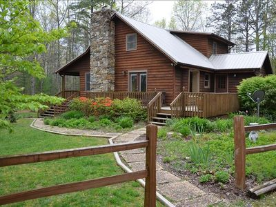 Four acres of wooded privacy and beautiful gardens