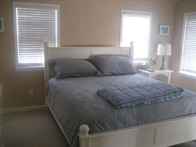 "Boardwalk house rental - Master bedroom w full bath and 32""Plazma TV."