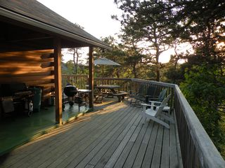 Wrap-around decks with magnificent tree top and sunset views - Wellfleet house vacation rental photo