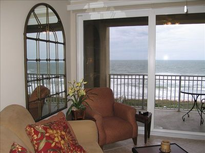 The family area is comfortable and looks out over the ocean.