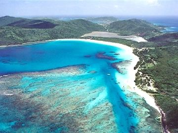 Aerial view of Flamenco Beach on airplane approach
