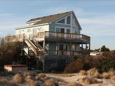 Oceanfront side of the house with photo of hot tub in the side