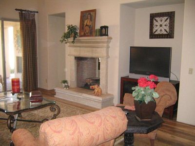 Great room with large TV and gas fireplace.