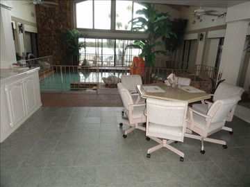 Game table & center island in front of heated saltwater pool. Great view!!!