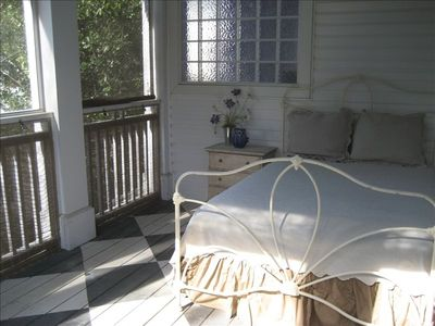 Take a nap outside on our sleeping porch...or read in the rain