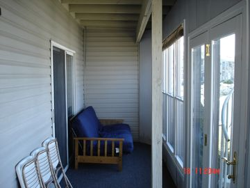 Screened in porch with double futon