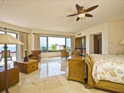 Large Master Bedroom Suite on the upper level with private sun-deck and views